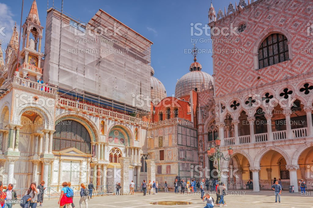 Square of the Holy Mark (Piazza San Marco) and St. Mark's Cathedral (Basilica di San Marco) with tourists. stock photo
