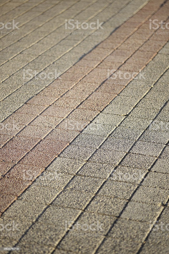Square pattern brown stone pavement stock photo