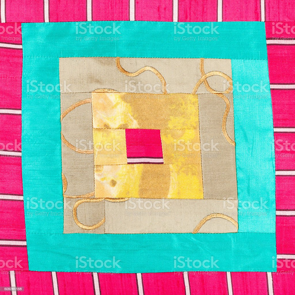 square pattern of patchwork cloth stock photo