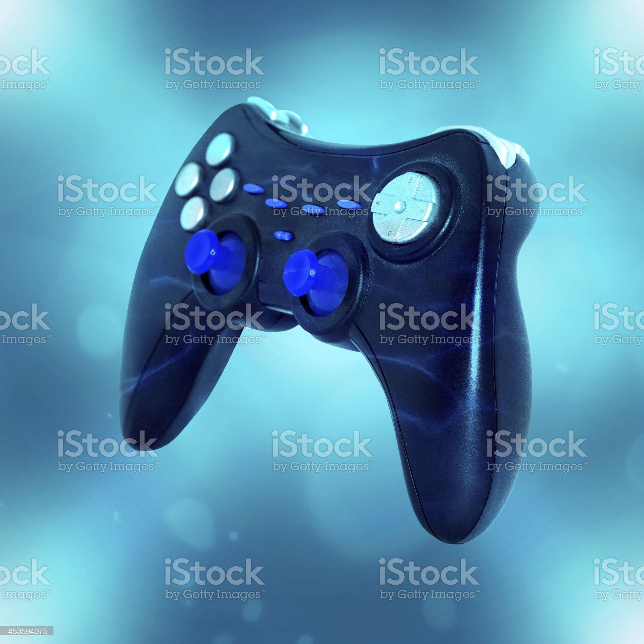 Square photo of joystick on blue background royalty-free stock photo