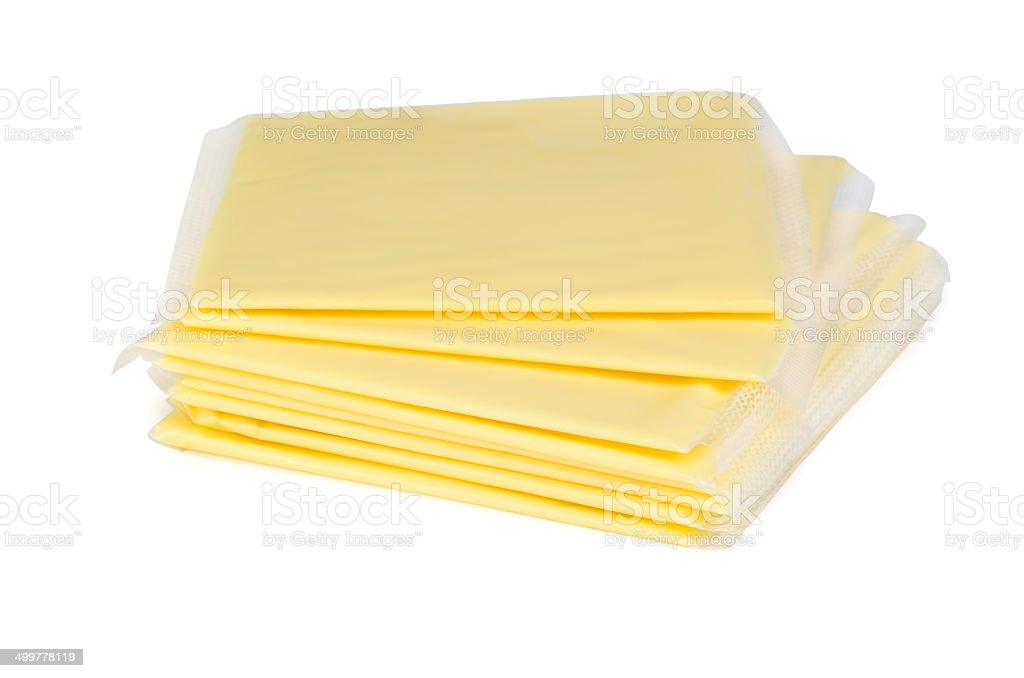 Square pieces of cheese in plastic packaging stock photo