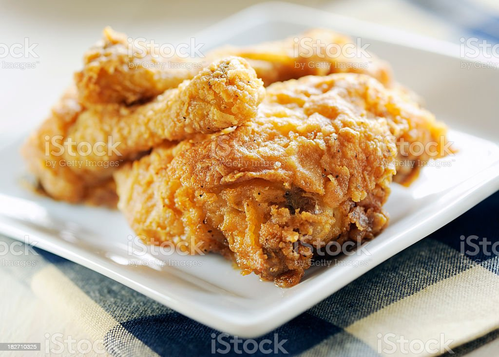 A square plate of fried chicken stock photo