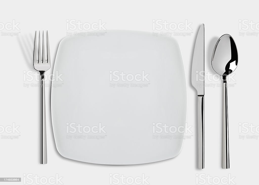 square plate with Knife, Spoon and Fork royalty-free stock photo