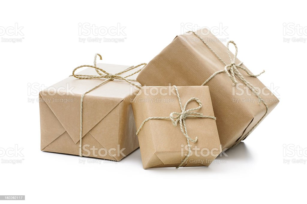 3 square presents wrapped in brown paper tied with string stock photo