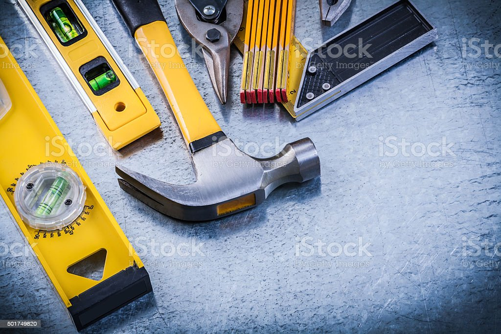 Square ruler construction level hammer pliers steel cutter woode stock photo