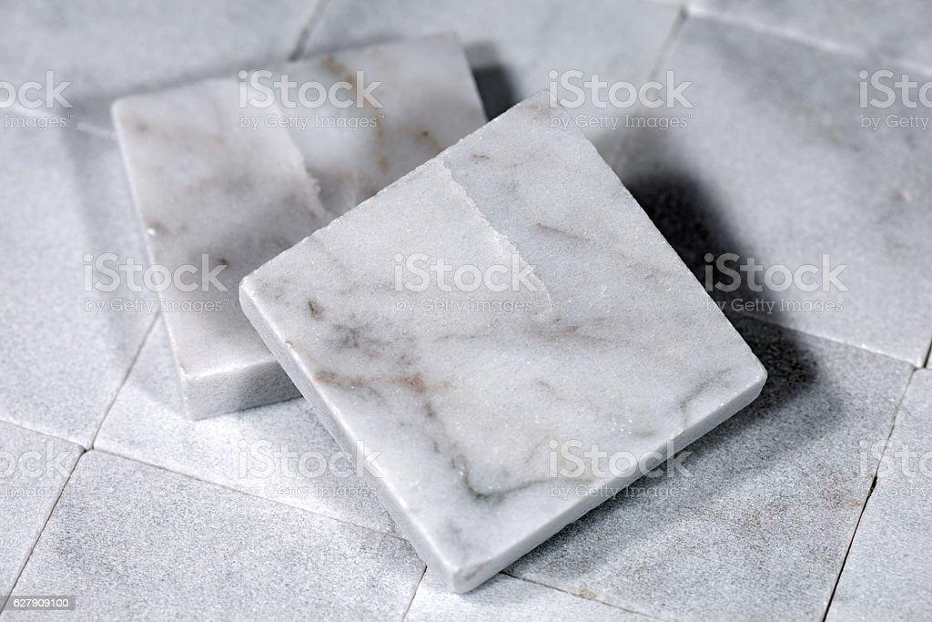 Square Tiles of White Carrara Marble stock photo