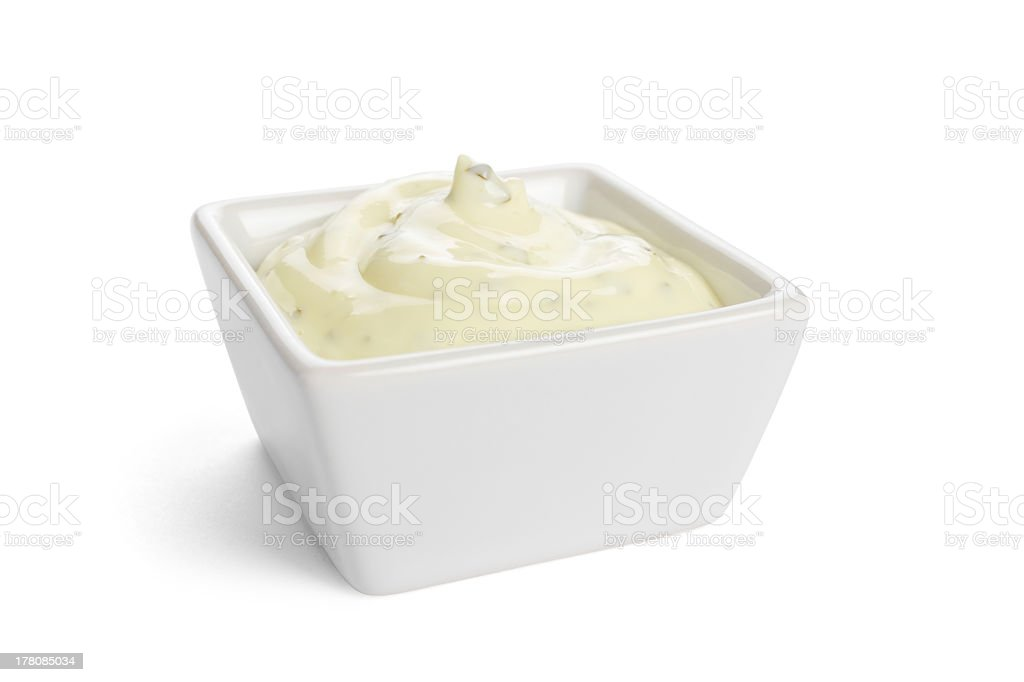 Square white bowl filled with tartar sauce stock photo
