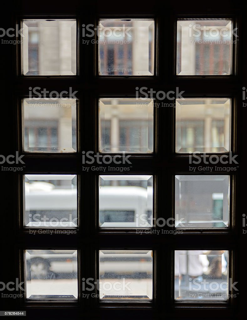 square windows in the door. Glass with bevel stock photo