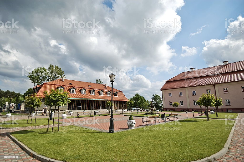 Square with benches in front of monastery royalty-free stock photo