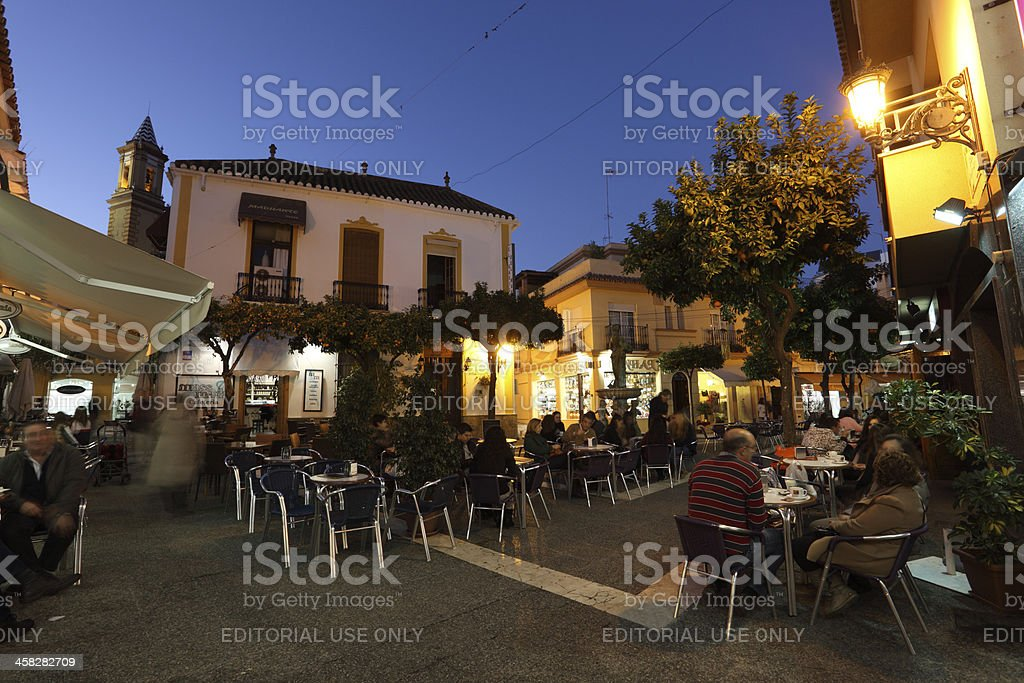 Square with cafes in Estepona, Spain stock photo