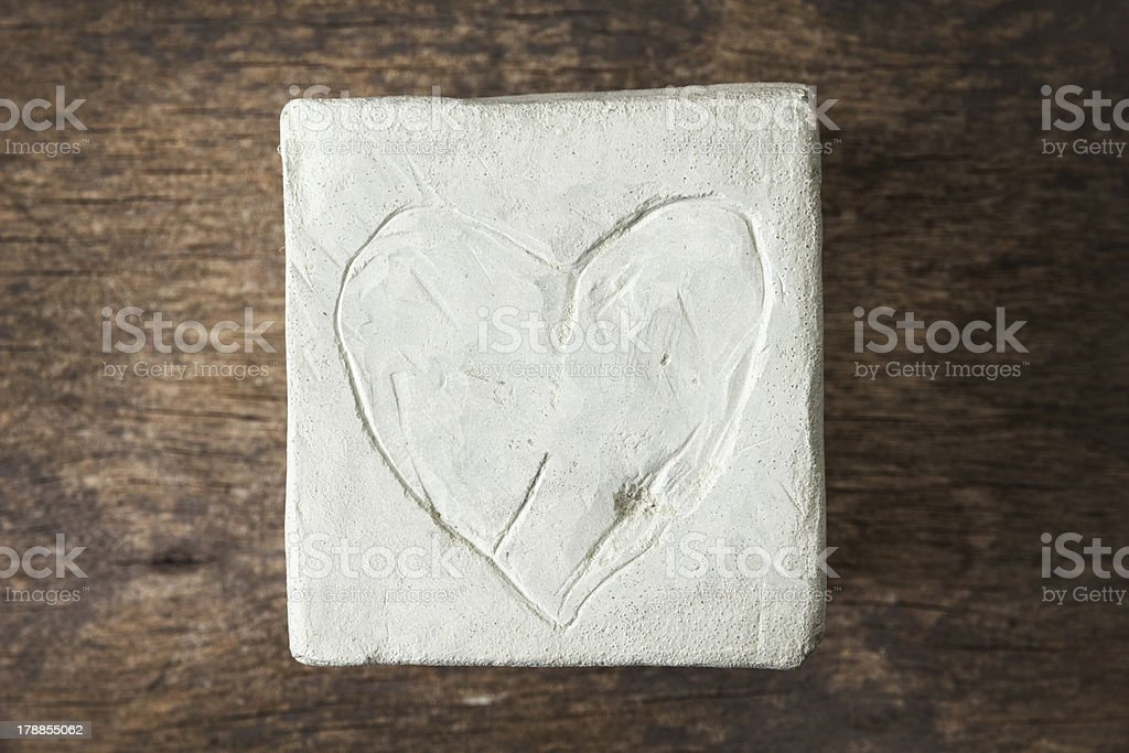 square with clay heart on wooden surface royalty-free stock photo
