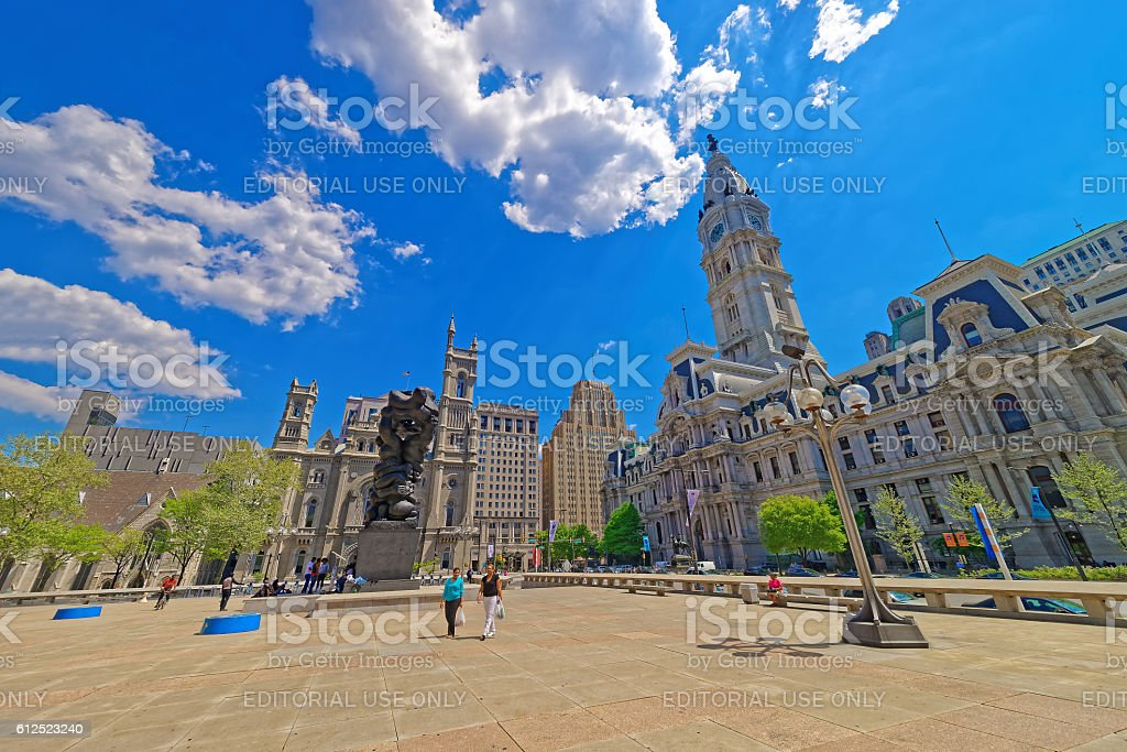 Square with sculpture and Philadelphia City Hall stock photo