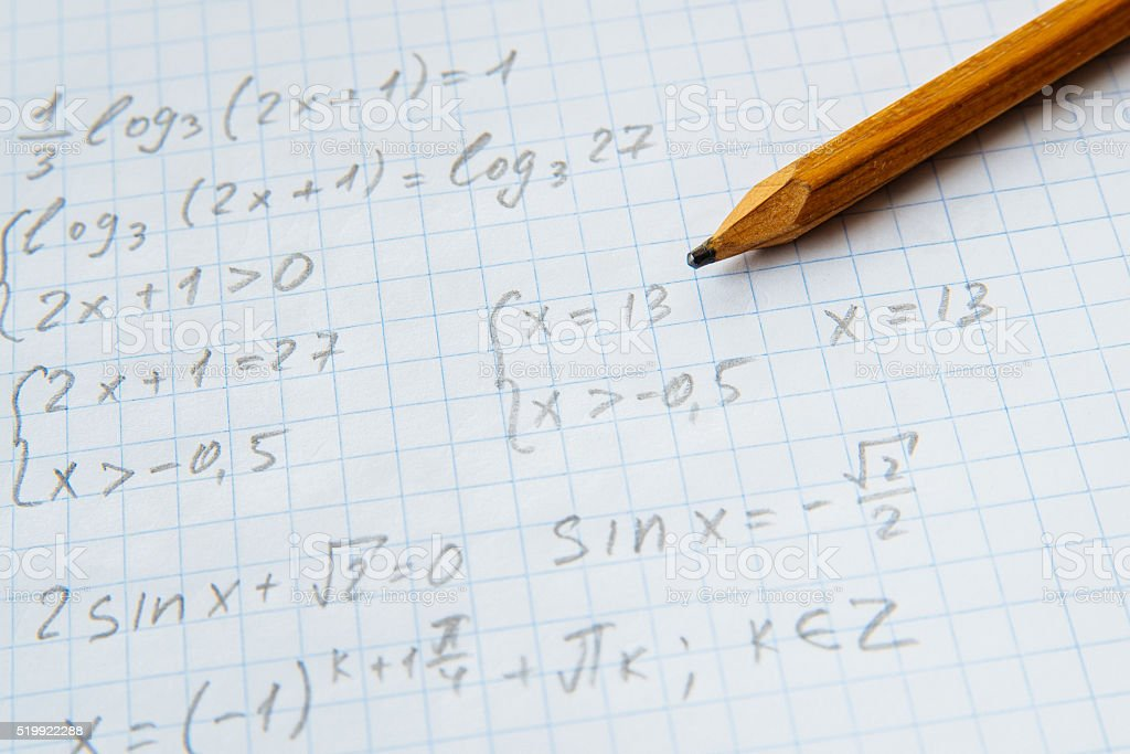 Squared sheet of paper filled with formulas stock photo