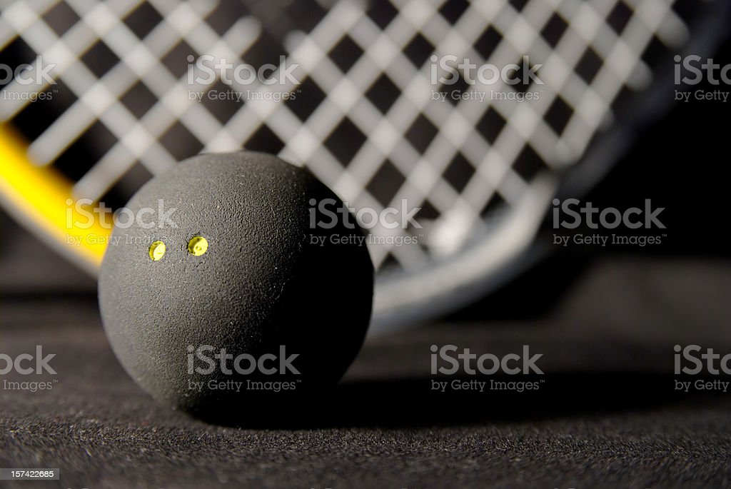 Squash ball and racket on black stock photo