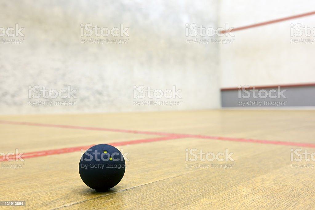 Squash ball in sport court royalty-free stock photo
