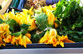 Squash Blossoms in Truck Bed (Close-Up)