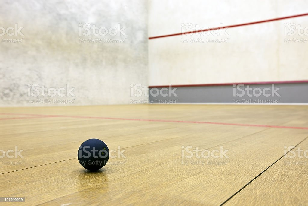 Squash court with pro ball lying on the floor stock photo