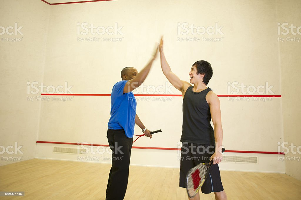 squash high five stock photo