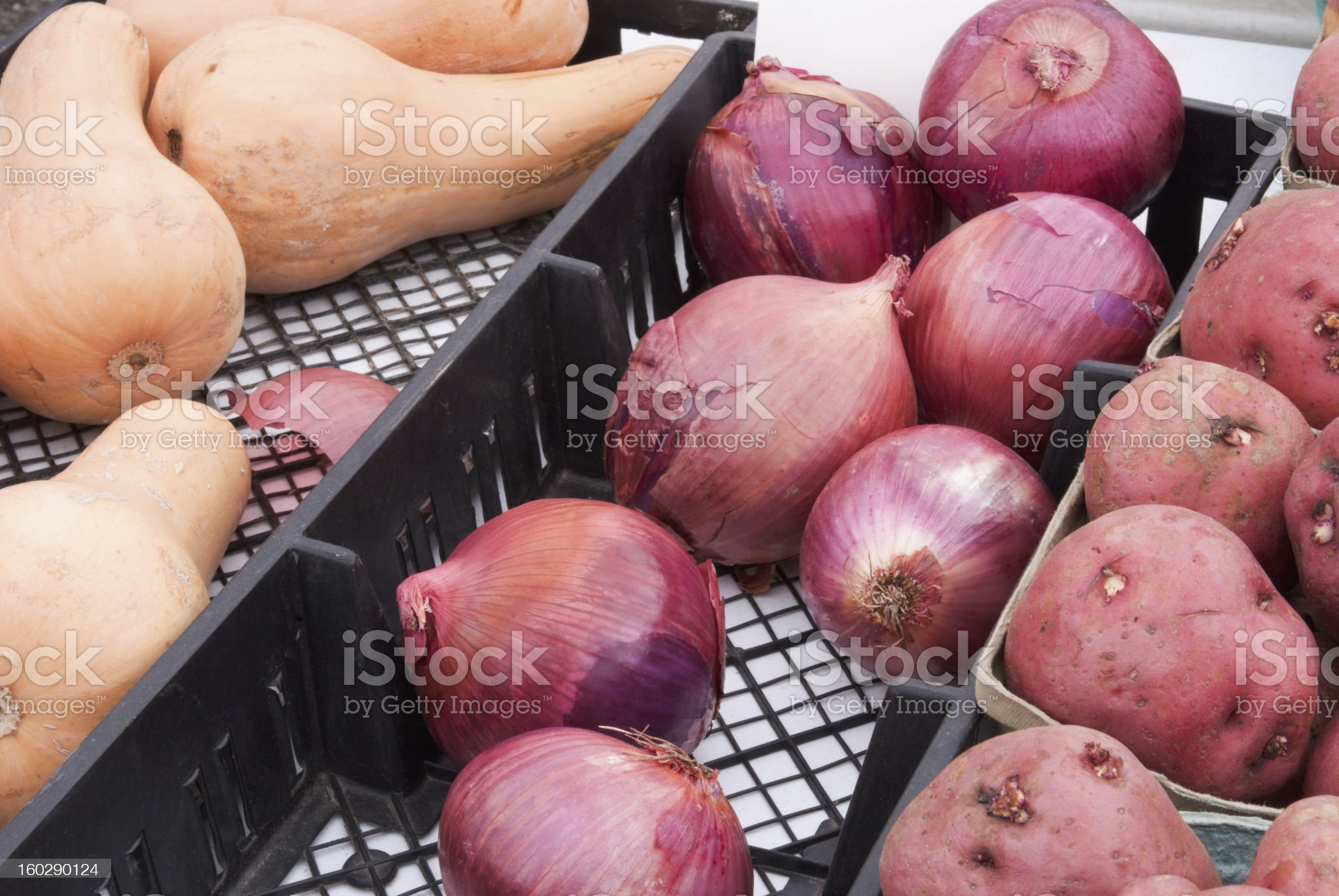 squash onions and potatoes for sale at a farmers market royalty-free stock photo