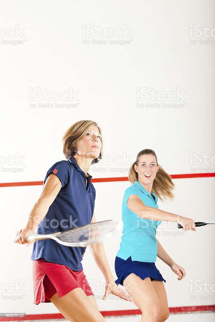 Squash racket sport in gym, women competition royalty-free stock photo