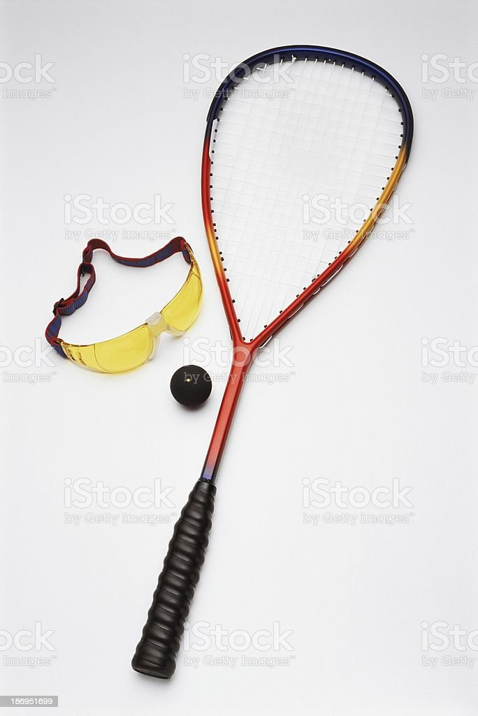 Squash racket with ball and goggles royalty-free stock photo