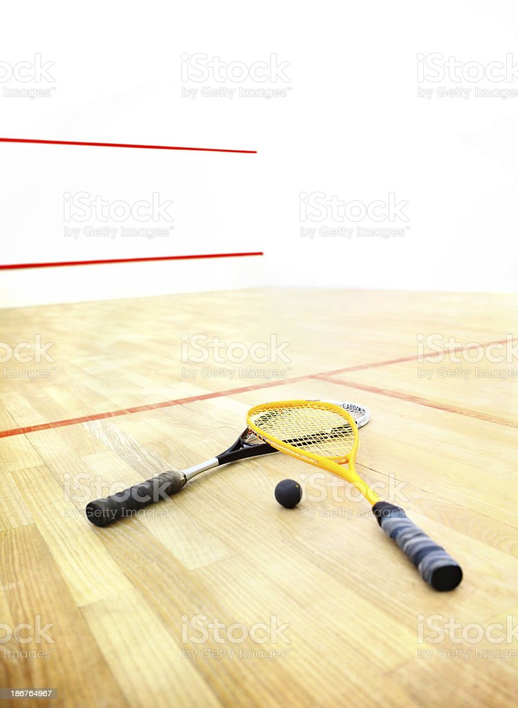 Squash rackets and  ball on a court. royalty-free stock photo