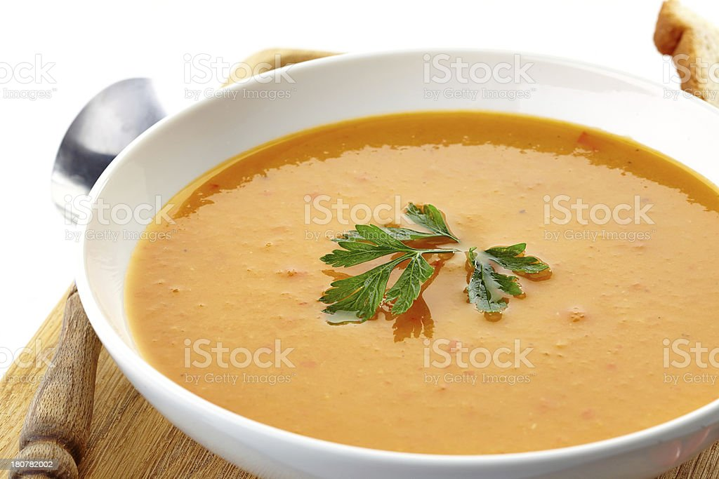 squash soup in a white plate royalty-free stock photo