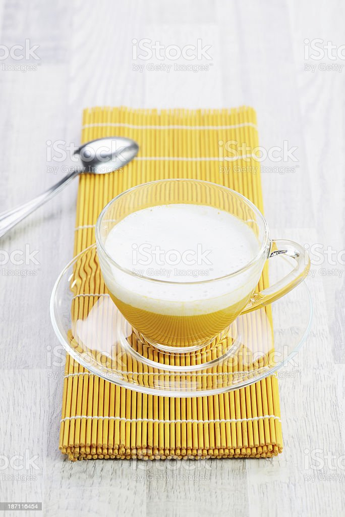 Squash Soup with Coconut Milk Froth royalty-free stock photo