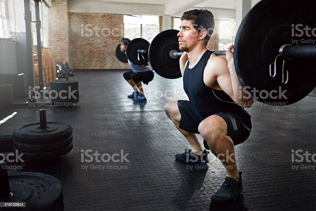 Squat and lift stock photo