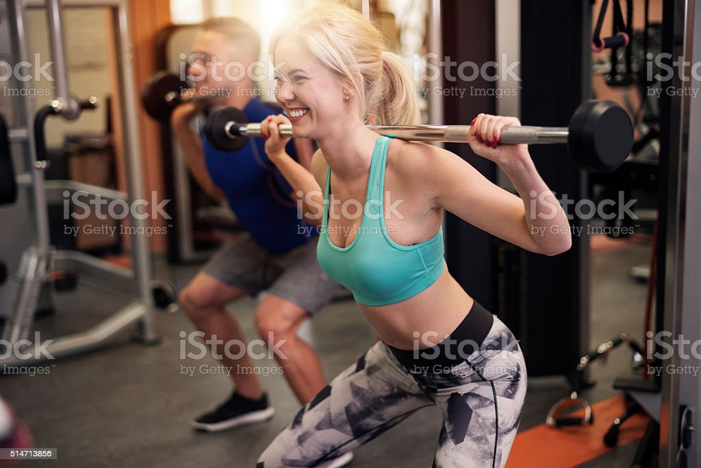 Squat exercise at the gym stock photo