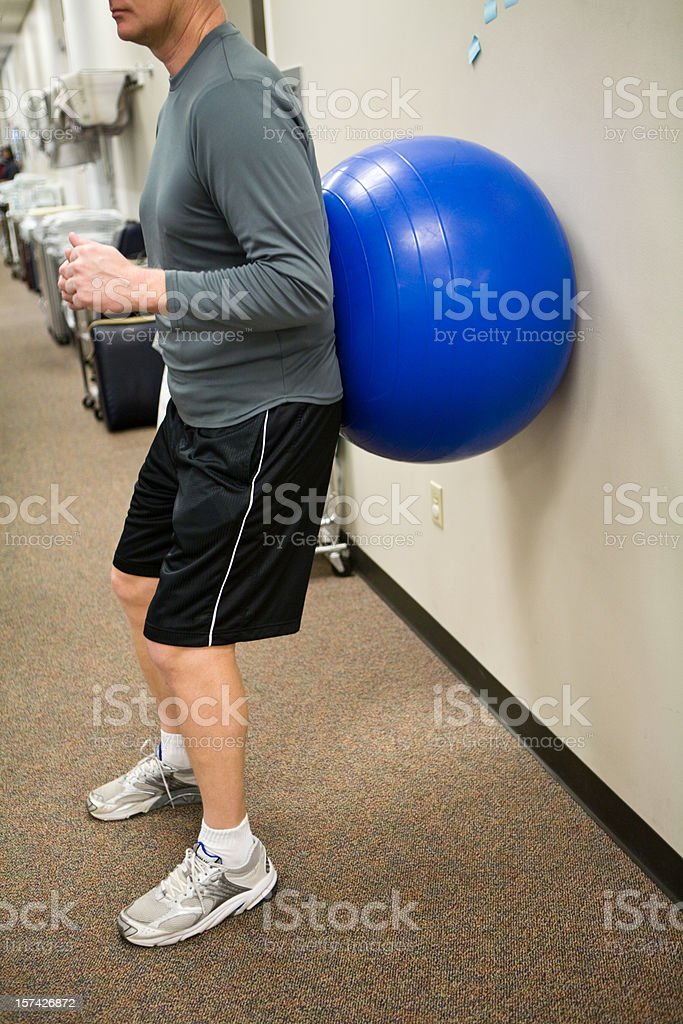 Squats with Exercise Ball royalty-free stock photo
