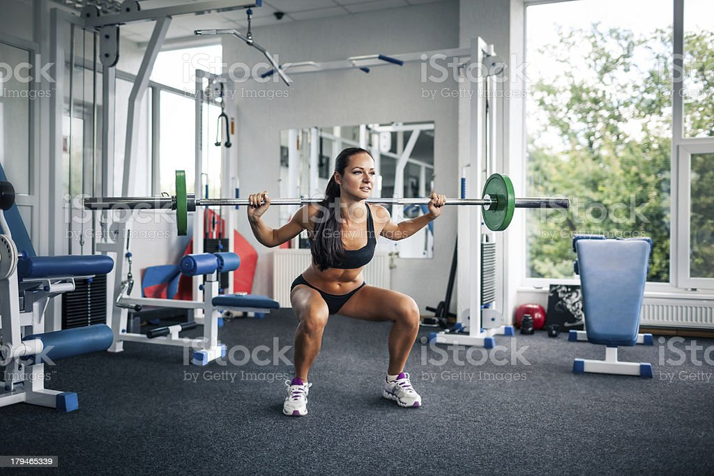 Squats with weights royalty-free stock photo