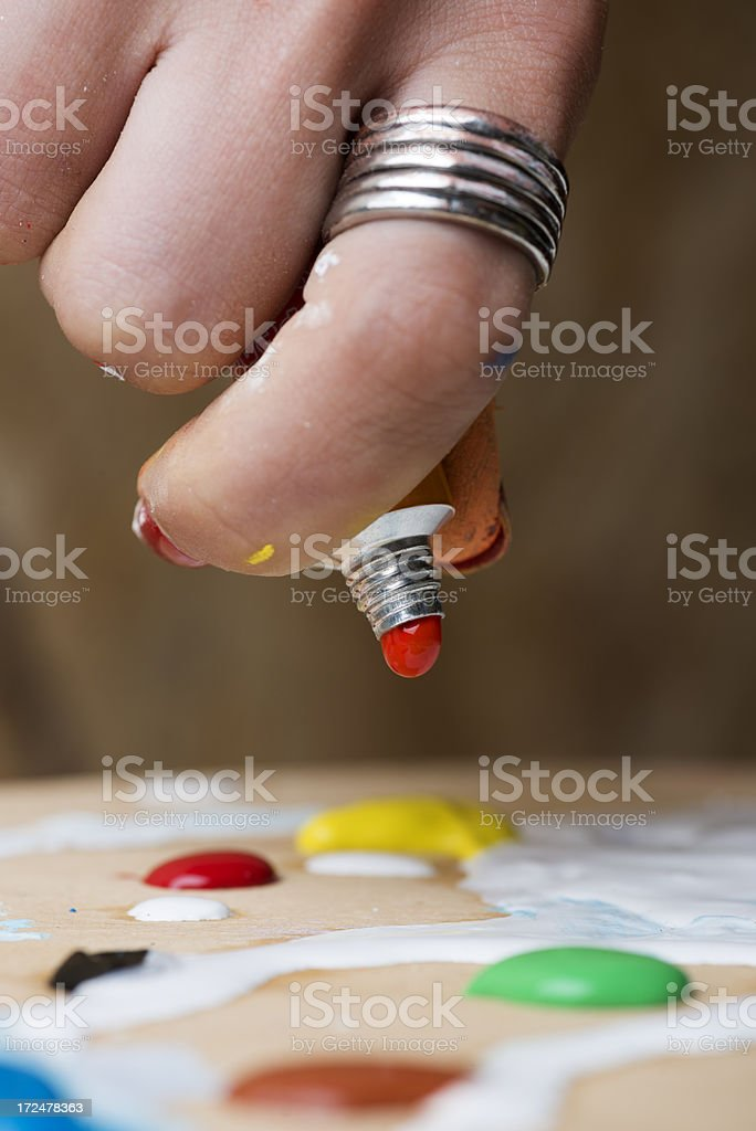 Squeeying Red Tempera royalty-free stock photo