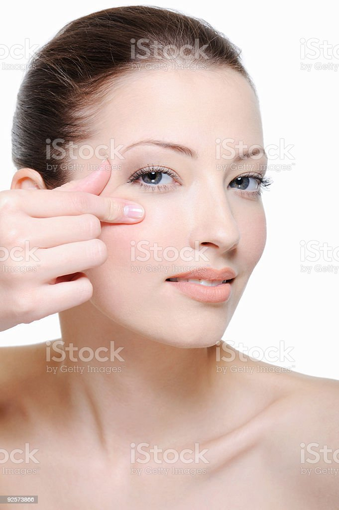 squeeze skin near eye royalty-free stock photo