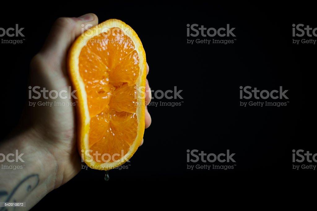 Squeeze The Orange stock photo