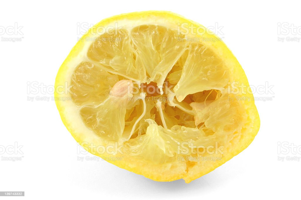 squeezed out lemon on white royalty-free stock photo