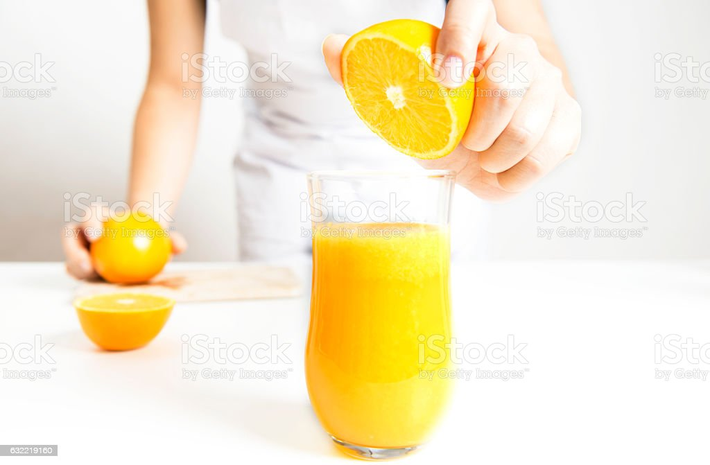 Squeezing Orange Juice stock photo