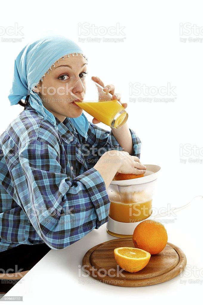 Squeezing oranges royalty-free stock photo