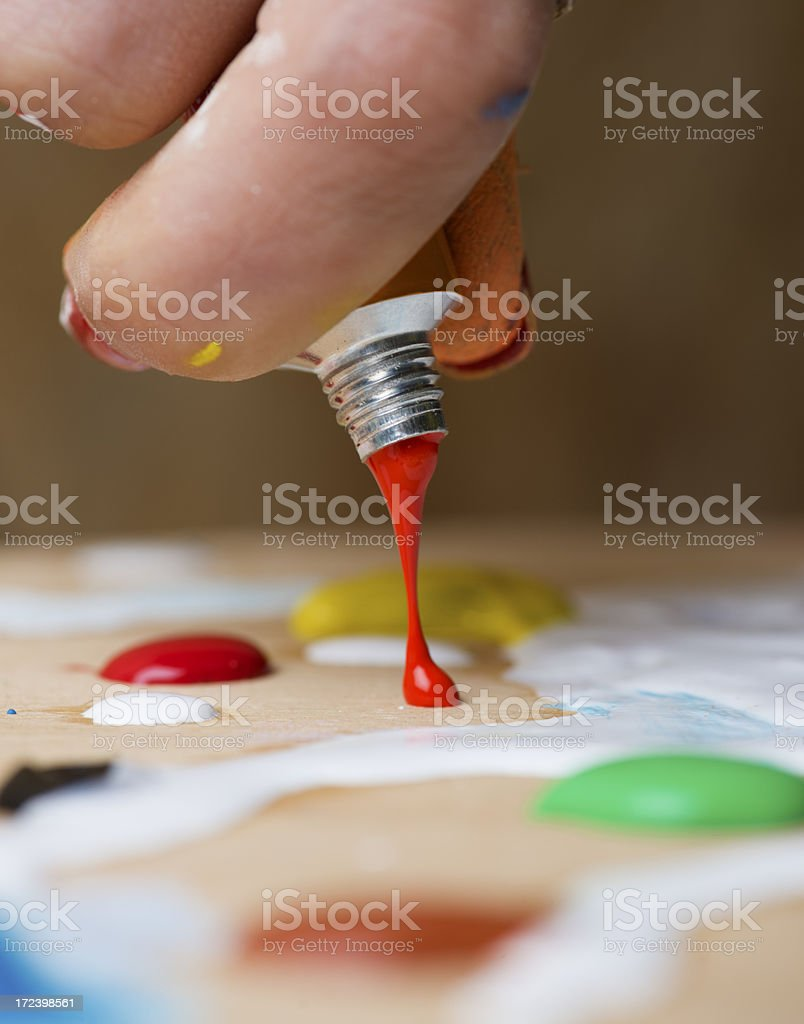 Squeezing Red Tempera royalty-free stock photo