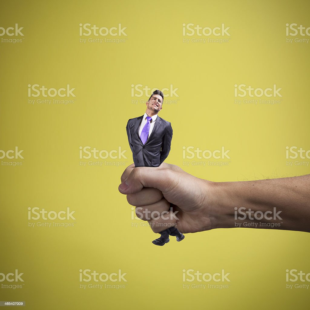 Squeezing the businessman stock photo