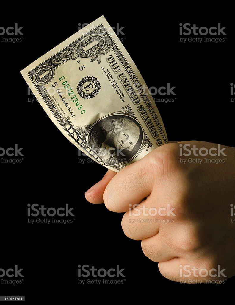 Squeezing the Dollar Note royalty-free stock photo