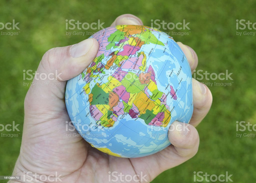 Squeezing the World royalty-free stock photo