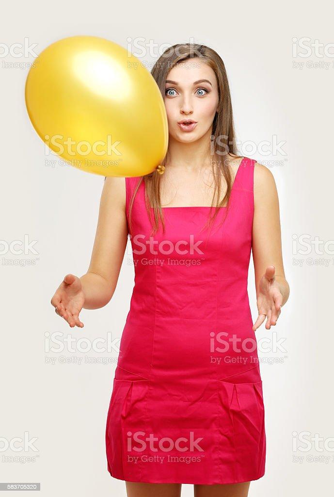 Squeezing yellow balloon stock photo