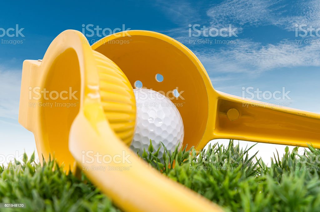 Squeezing your golf stock photo