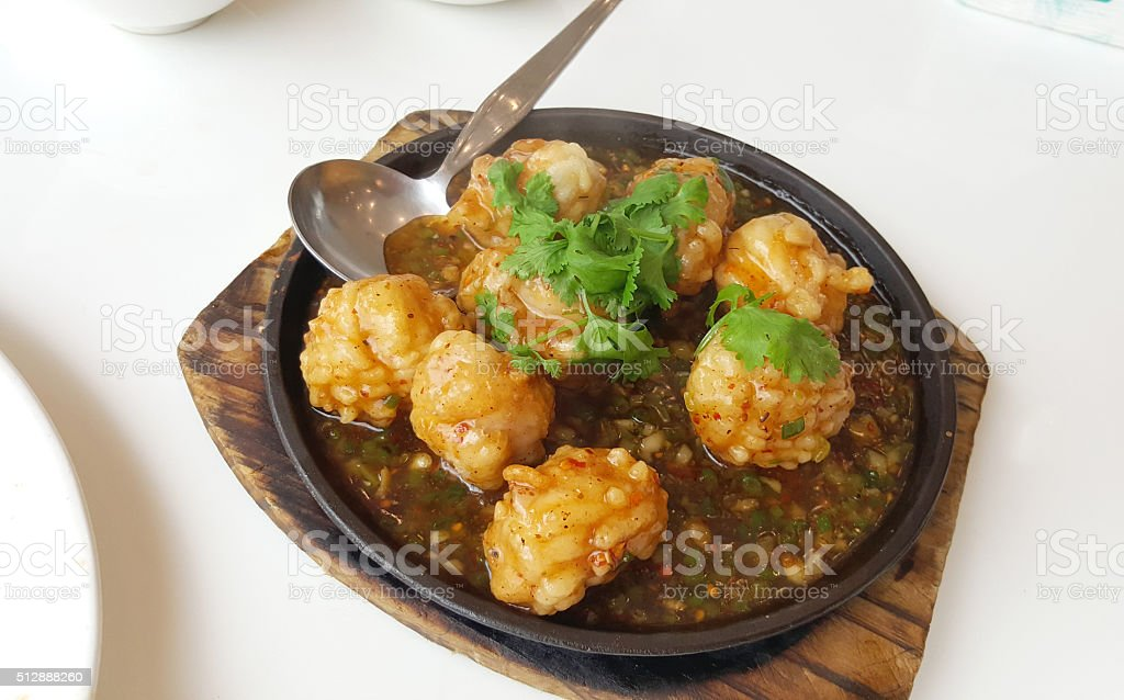 Squid balls serving on the hot plate stock photo