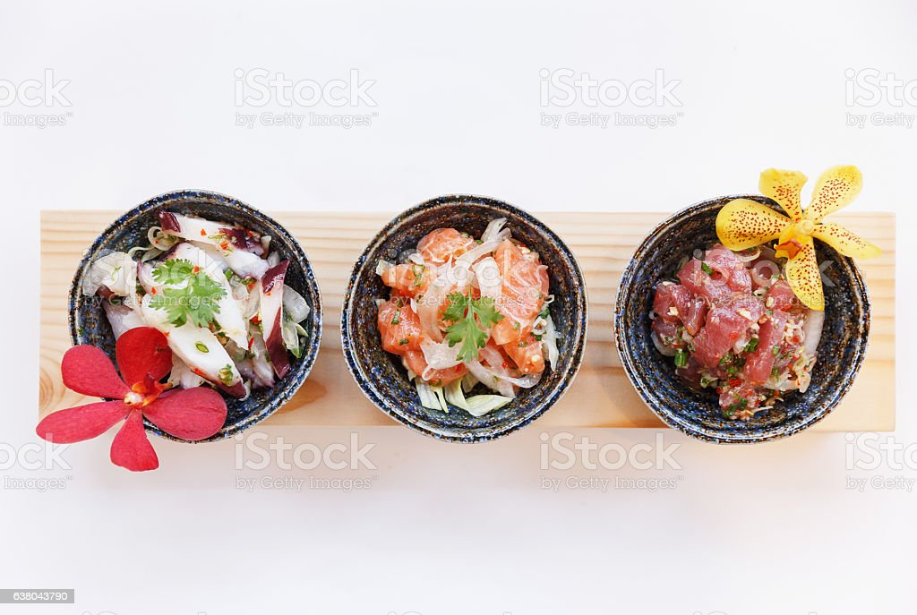 Squid, Raw Salmon and Maguro Spicy Salad. stock photo