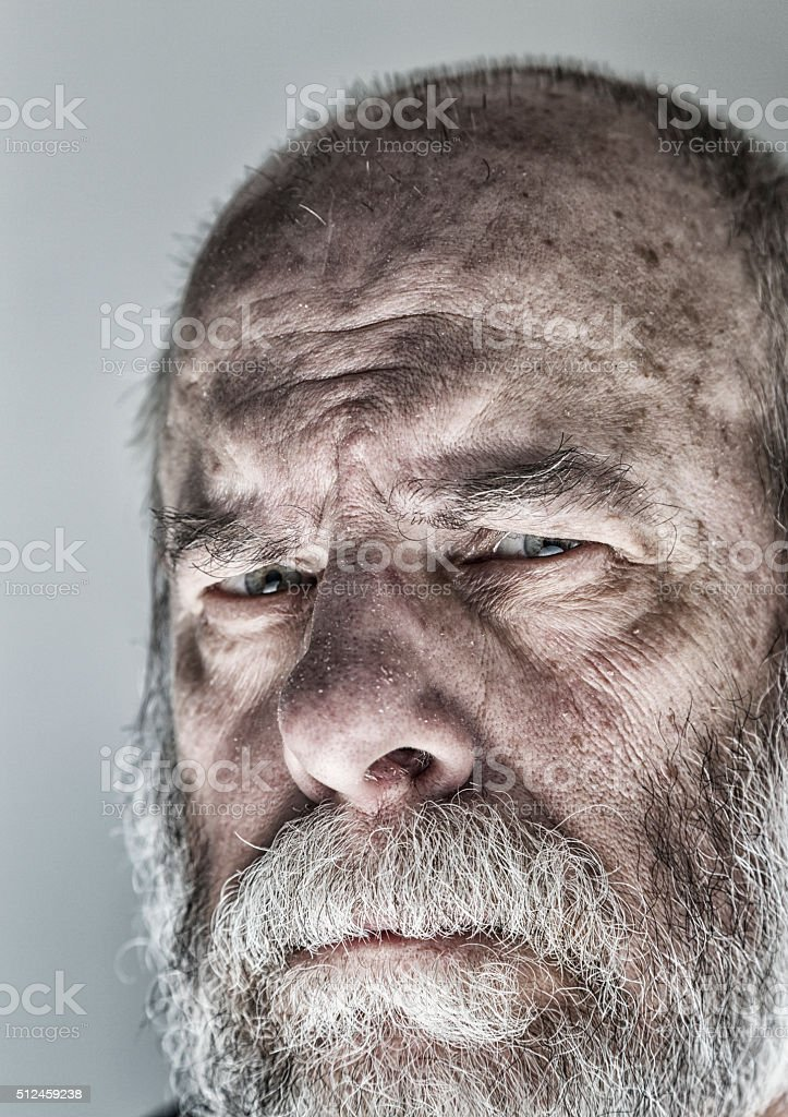 Squinting Flaky Skin Senior Man Skeptical Close-up Face Portrait stock photo
