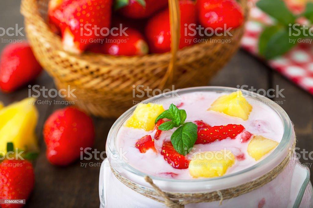 Srawberry and pineapple flavored yogurt stock photo