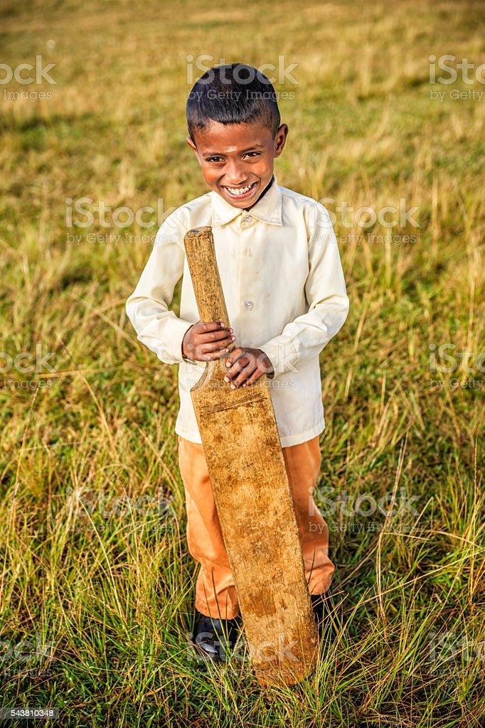 Sri Lankan boy posing with cricket bat on tea plantation stock photo