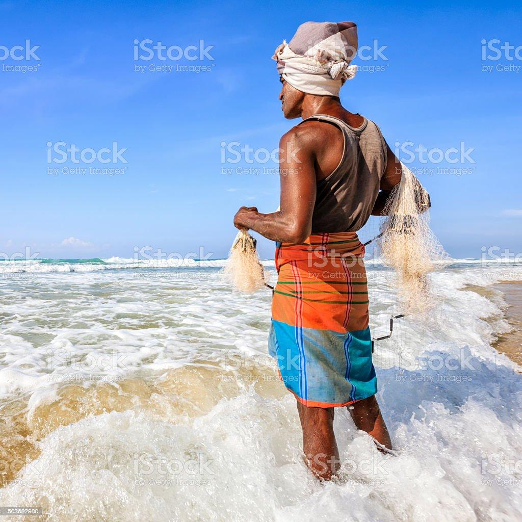 Sri Lankan fisherman throwing a fishing net near Mirissa stock photo